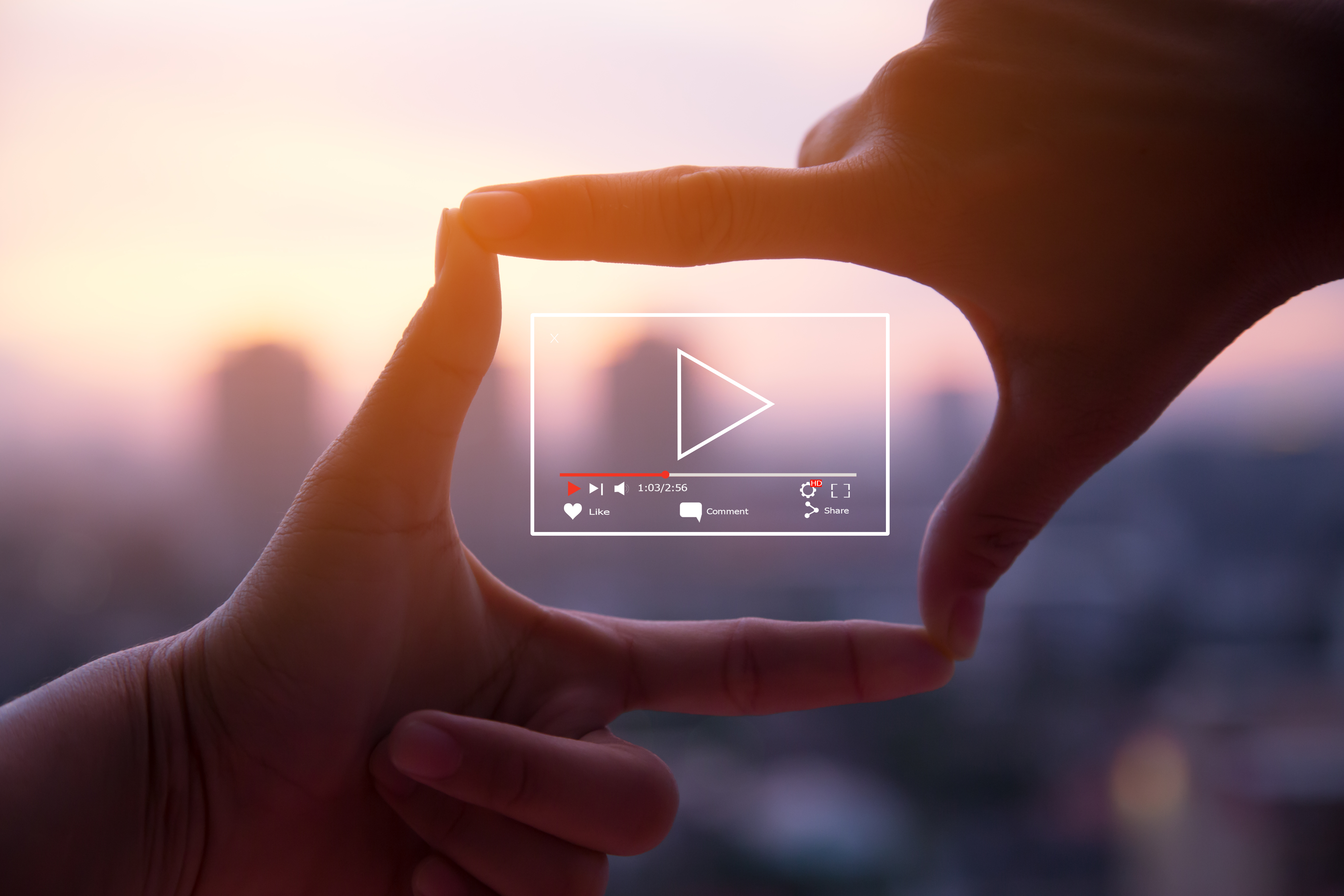 Two Hands Around a Play Video Button